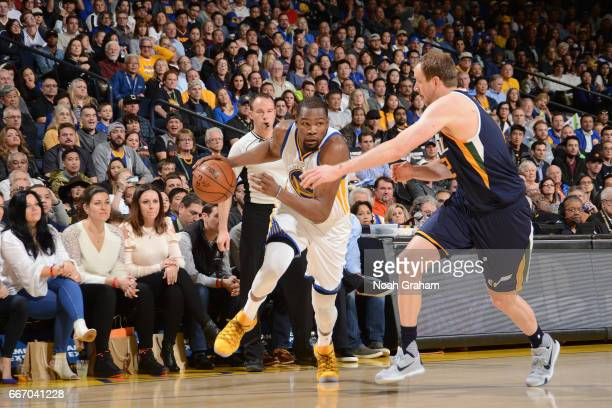 Kevin Durant of the Golden State Warriors handles the ball against the Utah Jazz on April 10 2017 at ORACLE Arena in Oakland California NOTE TO USER...
