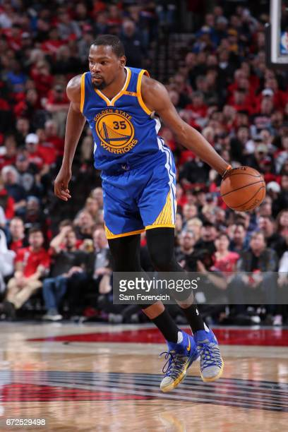 Kevin Durant of the Golden State Warriors handles the ball against the Portland Trail Blazers during Game Four of the Western Conference...