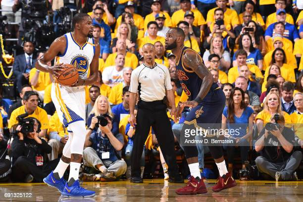 Kevin Durant of the Golden State Warriors handles the ball against LeBron James of the Cleveland Cavaliers during Game One of the 2017 NBA Finals at...