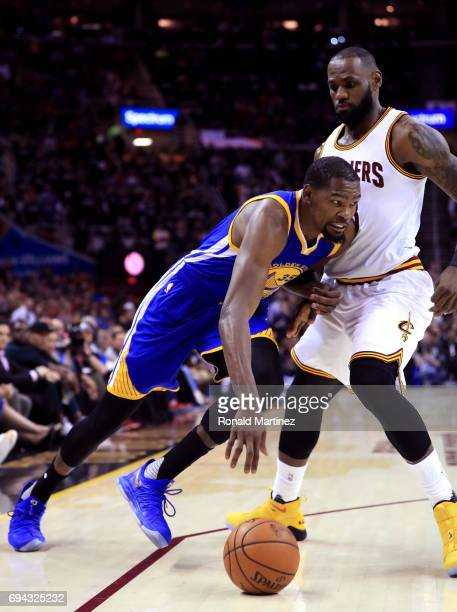 Kevin Durant of the Golden State Warriors handles the ball against LeBron James of the Cleveland Cavaliers in the first quarter in Game 4 of the 2017...
