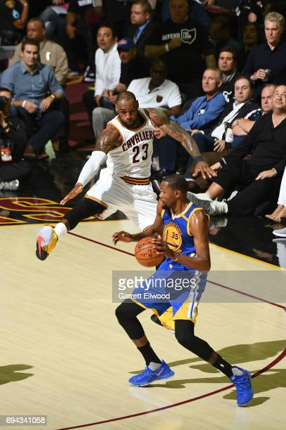 Kevin Durant of the Golden State Warriors handles the ball against LeBron James of the Cleveland Cavaliers in Game Four of the 2017 NBA Finals on...