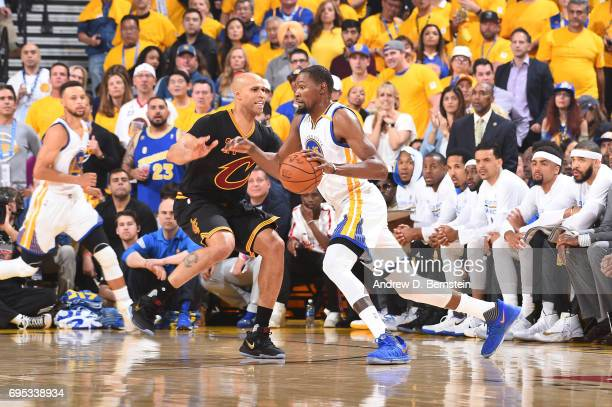 Kevin Durant of the Golden State Warriors handles the ball against Richard Jefferson of the Cleveland Cavaliers in Game Five of the 2017 NBA Finals...