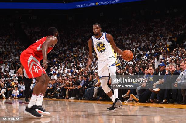 Kevin Durant of the Golden State Warriors handles the ball against the Houston Rockets on October 17 2017 at ORACLE Arena in Oakland California NOTE...