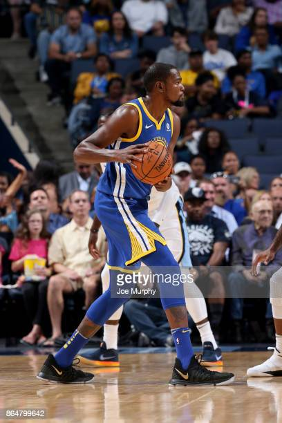 Kevin Durant of the Golden State Warriors handles the ball against the Memphis Grizzlies on October 21 2017 at FedExForum in Memphis Tennessee NOTE...