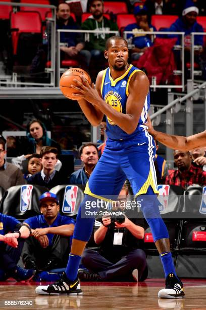 Kevin Durant of the Golden State Warriors handles the ball against the Detroit Pistons on December 8 2017 at Little Caesars Arena in Detroit Michigan...