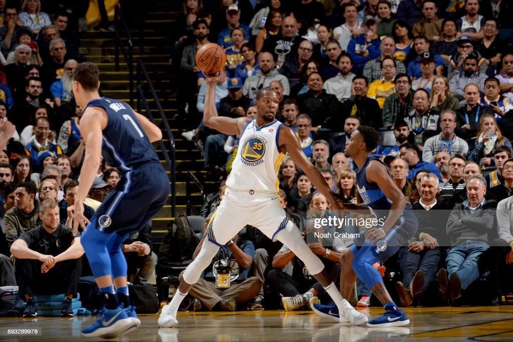 Kevin Durant #35 of the Golden State Warriors handles the ball against the Dallas Mavericks on December 14, 2017 at ORACLE Arena in Oakland, California.
