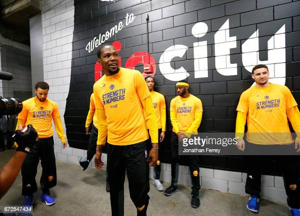 Kevin Durant of the Golden State Warriors hangs out with teammates before the game against the Portland Trail Blazers during Game Four of the Western...