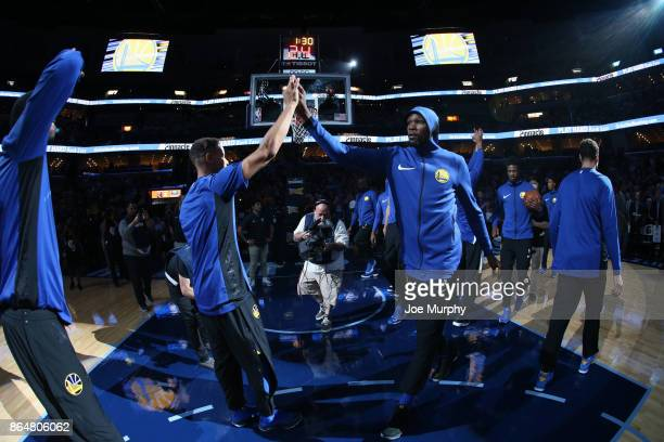 Kevin Durant of the Golden State Warriors high fives his teammates before the game against the Memphis Grizzlies on October 21 2017 at FedExForum in...