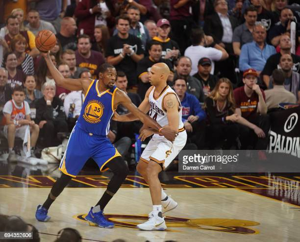 Kevin Durant of the Golden State Warriors holds the ball while defended by Richard Jefferson of the Cleveland Cavaliers in Game Four of the 2017 NBA...