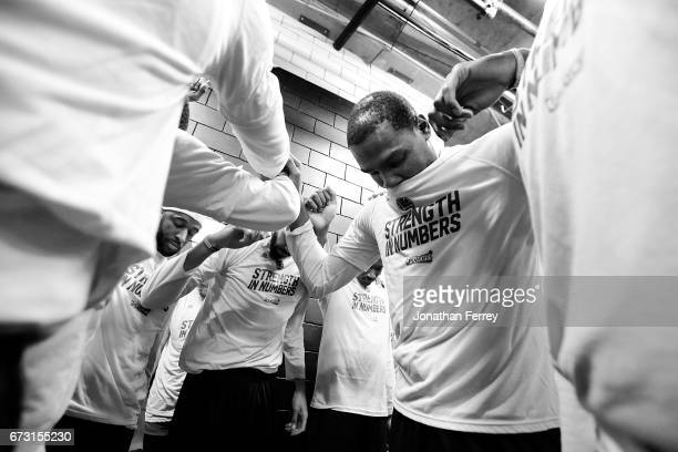 Kevin Durant of the Golden State Warriors huddles with teammates before the game against the Portland Trail Blazers during Game Four of the Western...