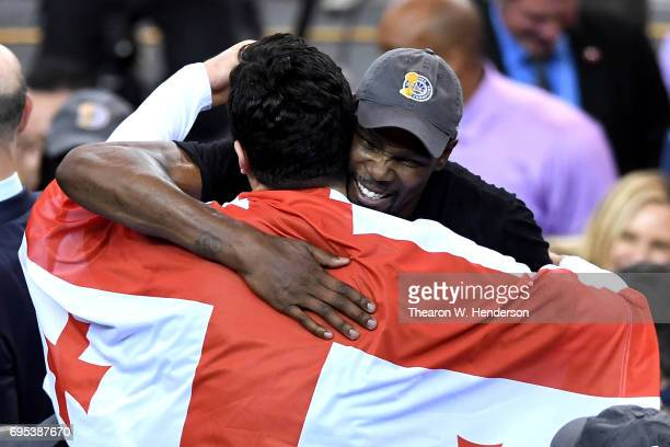 Kevin Durant of the Golden State Warriors hugs Zaza Pachulia after defeating the Cleveland Cavaliers 129120 in Game 5 to win the 2017 NBA Finals at...