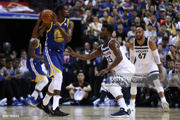 Kevin Durant of the Golden State Warriors in action against Jimmy Butler of the Minnesota Timberwolves during the game between the Minnesota...