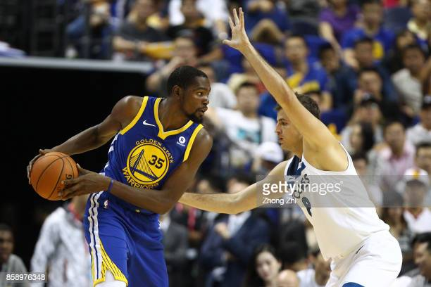 Kevin Durant of the Golden State Warriors in action against Nemanja Bjelica of the Minnesota Timberwolves during the game between the Minnesota...