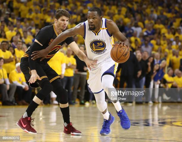 Kevin Durant of the Golden State Warriors is defended by Kyle Korver of the Cleveland Cavaliers during the second half in Game 5 of the 2017 NBA...