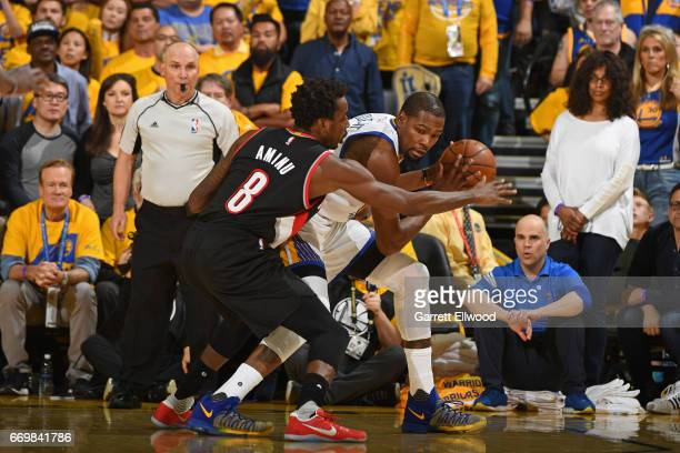 Kevin Durant of the Golden State Warriors is guarded by AlFarouq Aminu of the Portland Trail Blazers during the Western Conference Quarterfinals game...