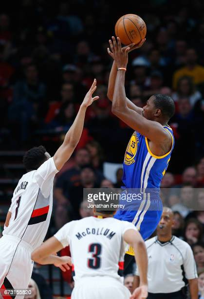 Kevin Durant of the Golden State Warriors is guarded by by Evan Turner of the Portland Trail Blazers during Game Four of the Western Conference...
