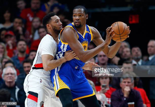 Kevin Durant of the Golden State Warriors is guarded by by Maurice Harkless of the Portland Trail Blazers during Game Four of the Western Conference...
