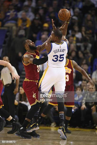 Kevin Durant of the Golden State Warriors is guarded by LeBron James of the Cleveland Cavaliers at ORACLE Arena on January 16 2017 in Oakland...