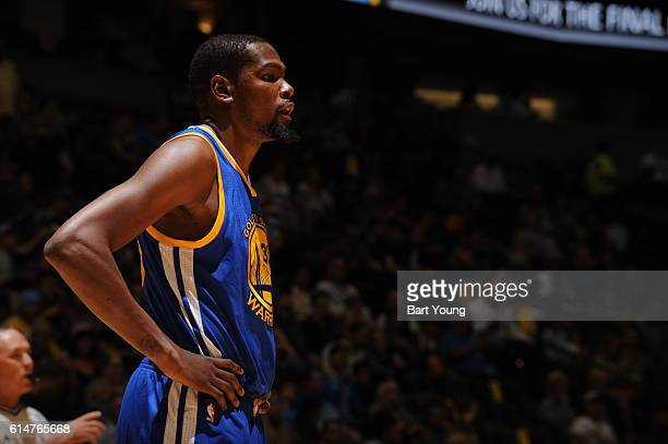 Kevin Durant of the Golden State Warriors looks on against the Denver Nuggets during a preseason game on October 14 2016 at the Pepsi Center in...