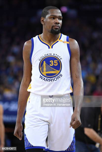 Kevin Durant of the Golden State Warriors looks on during a timeout during an NBA Basketball game against the Sacramento Kings at ORACLE Arena on...