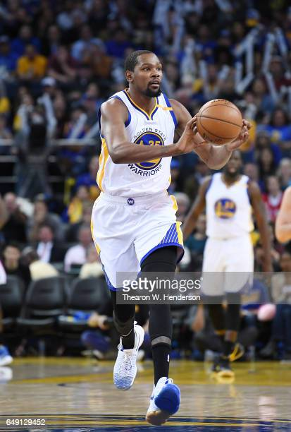 Kevin Durant of the Golden State Warriors looks to pass the ball up court against the LA Clippers during an NBA basketball game at ORACLE Arena on...