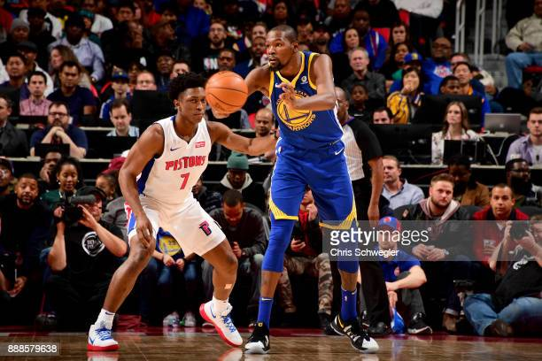Kevin Durant of the Golden State Warriors passes the ball against the Detroit Pistons on December 8 2017 at Little Caesars Arena in Detroit Michigan...