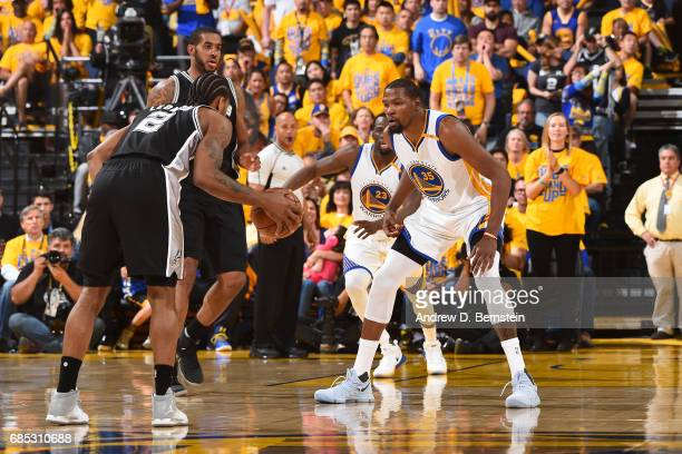 Kevin Durant of the Golden State Warriors plays defense against Kawhi Leonard of the San Antonio Spurs in Game One of the Western Conference Finals...