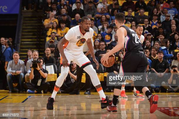 Kevin Durant of the Golden State Warriors plays defense against Austin Rivers of the LA Clippers on January 28 2017 at ORACLE Arena in Oakland...