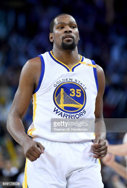Kevin Durant of the Golden State Warriors reacts after making a threepoint shot against the LA Clippers during an NBA basketball game at ORACLE Arena...