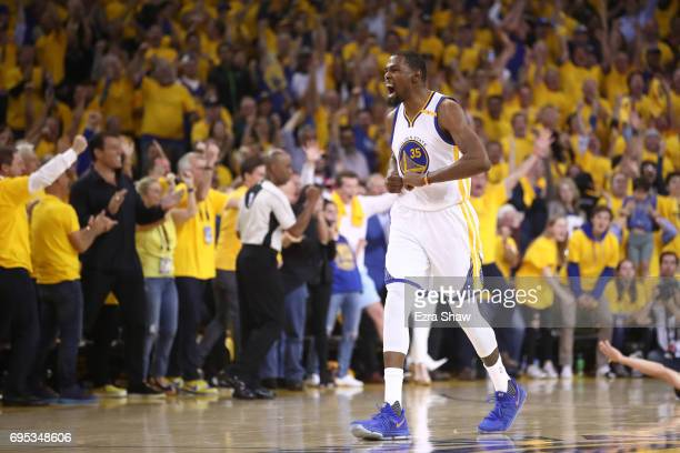 Kevin Durant of the Golden State Warriors reacts against the Cleveland Cavaliers during the first half in Game 5 of the 2017 NBA Finals at ORACLE...