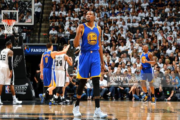 Kevin Durant of the Golden State Warriors reacts during the game against the San Antonio Spurs during Game Three of the Western Conference Finals of...