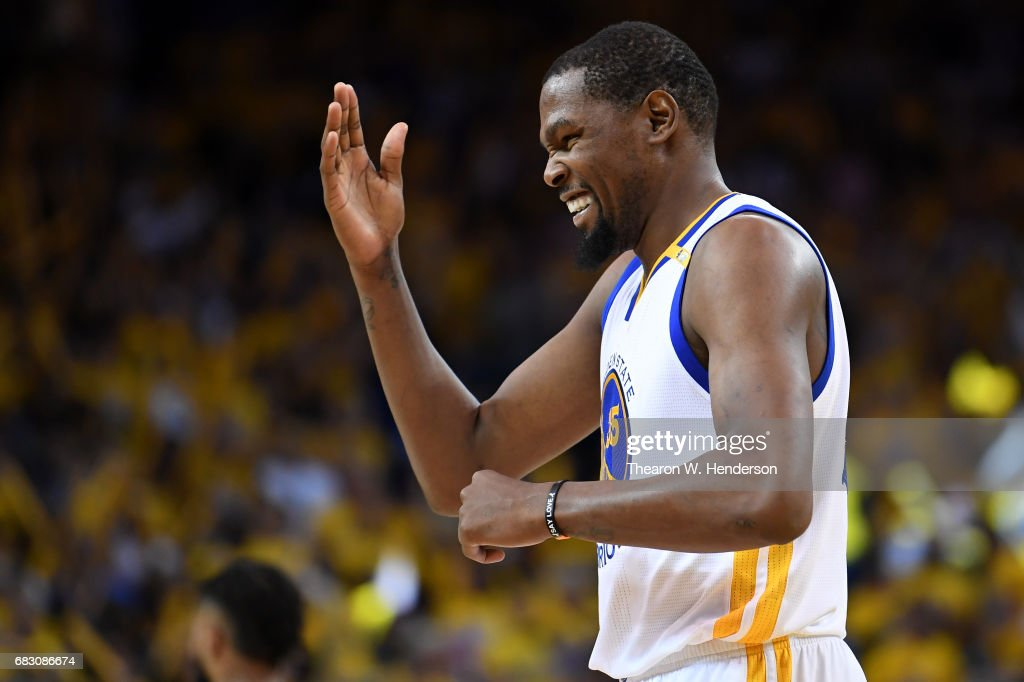 Kevin Durant #35 of the Golden State Warriors reacts to a basket against the San Antonio Spurs during Game One of the NBA Western Conference Finals at ORACLE Arena on May 14, 2017 in Oakland, California.