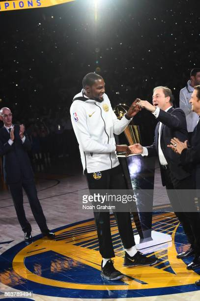 Kevin Durant of the Golden State Warriors receives his rings during the NBA Championship ring ceremony before the game against the Houston Rockes on...