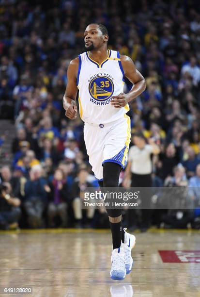Kevin Durant of the Golden State Warriors runs back up court after making a basket against the LA Clippers during an NBA basketball game at ORACLE...