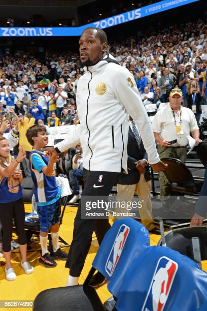 Kevin Durant of the Golden State Warriors runs out of the tunnel before the game against the Houston Rockets on October 17 2017 at ORACLE Arena in...