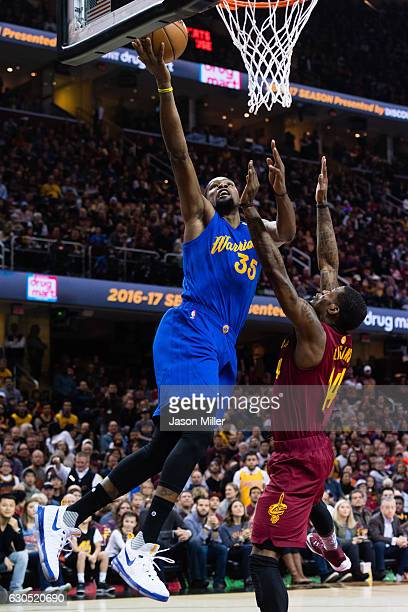 Kevin Durant of the Golden State Warriors scores over DeAndre Liggins of the Cleveland Cavaliers during the first half at Quicken Loans Arena on...