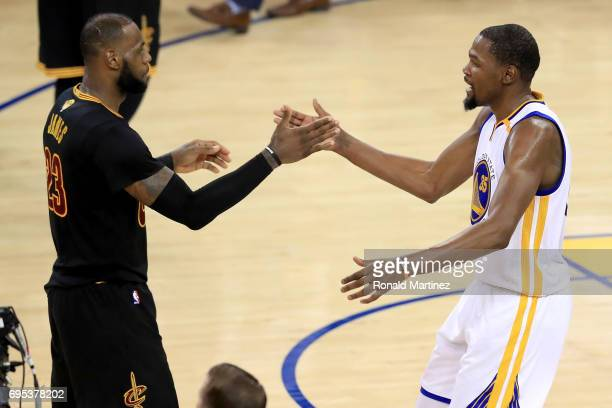 Kevin Durant of the Golden State Warriors shakes hands with LeBron James of the Cleveland Cavaliers after defeating the Cleveland Cavaliers 129120 in...