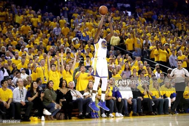 Kevin Durant of the Golden State Warriors shoots a threepoint shot in Game 1 of the 2017 NBA Finals against the Cleveland Cavaliers at ORACLE Arena...