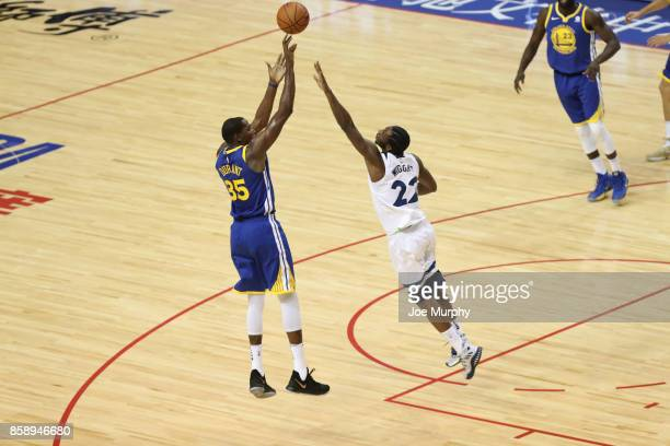Kevin Durant of the Golden State Warriors shoots against Andrew Wiggins of the Minnesota Timberwolves as part of the 2017 Global Games China on...