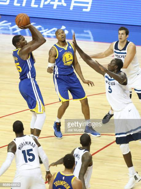 Kevin Durant of the Golden State Warriors shoots against Gorgui Dieng of the Minnesota Timberwolves as part of the 2017 Global Games China on October...