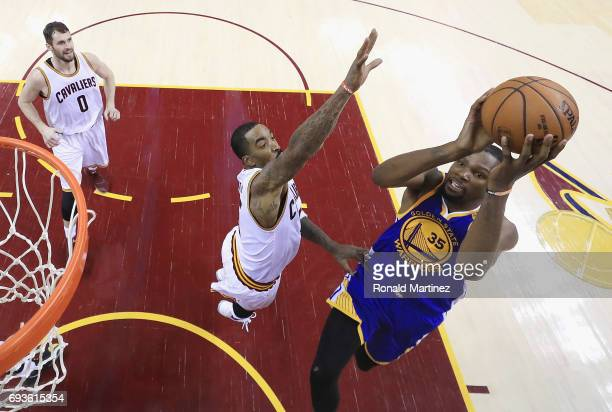 Kevin Durant of the Golden State Warriors shoots against JR Smith of the Cleveland Cavaliers in the second half in Game 3 of the 2017 NBA Finals at...