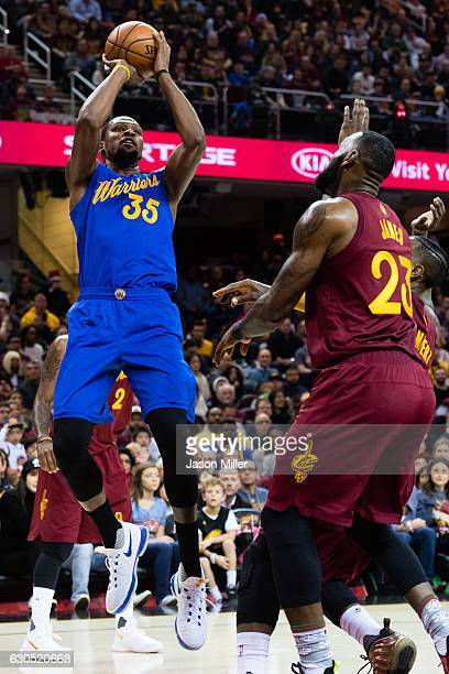 Kevin Durant of the Golden State Warriors shoots over LeBron James of the Cleveland Cavaliers during the first half at Quicken Loans Arena on...