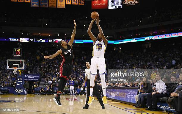 Kevin Durant of the Golden State Warriors shoots over Rodney McGruder of the Miami Heat at ORACLE Arena on January 10 2017 in Oakland California NOTE...