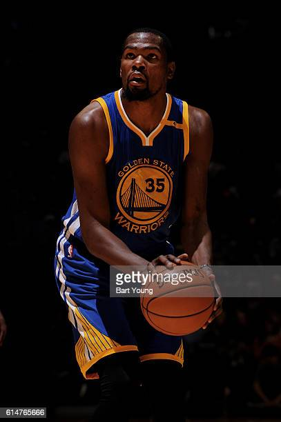 Kevin Durant of the Golden State Warriors shoots the ball against the Denver Nuggets during a preseason game on October 14 2016 at the Pepsi Center...
