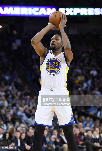 Kevin Durant of the Golden State Warriors shoots the ball against the LA Clippers during an NBA basketball game at ORACLE Arena on February 23 2017...