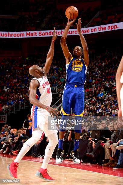 Kevin Durant of the Golden State Warriors shoots the ball against the Detroit Pistons on December 8 2017 at Little Caesars Arena in Detroit Michigan...