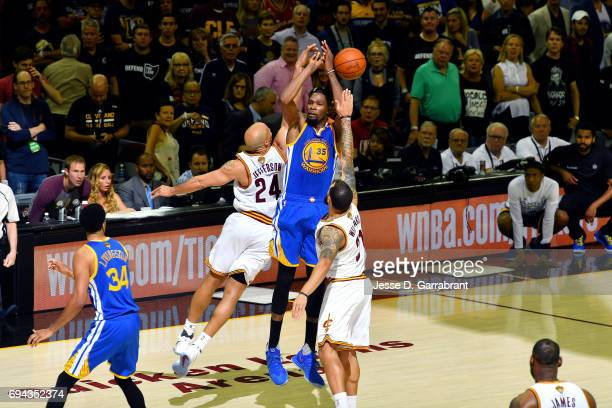 Kevin Durant of the Golden State Warriors shoots the ball and gets blocked by Richard Jefferson of the Cleveland Cavaliers during the game in Game...