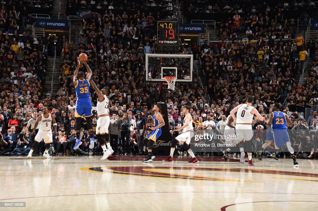 Kevin Durant #35 of the Golden State Warriors shoots the go ahead three pointer in the fourth quarter against LeBron James #23 of the Cleveland Cavaliers in Game Three of the 2017 NBA Finals on June 7, 2017 at Quicken Loans Arena in Cleveland, Ohio.