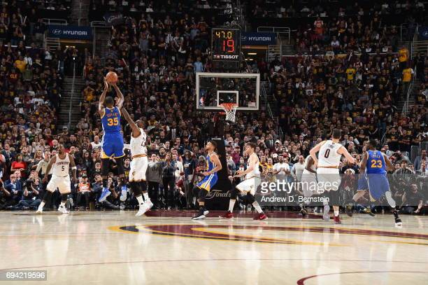 Kevin Durant of the Golden State Warriors shoots the go ahead three pointer in the fourth quarter against LeBron James of the Cleveland Cavaliers in...