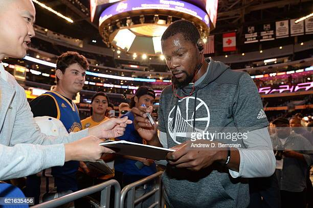 Kevin Durant of the Golden State Warriors signs autographs before the game against the Los Angeles Lakers on November 4 2016 at STAPLES Center in Los...
